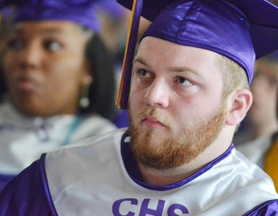 CHS senior Cody Cox listens as Principal Weston Jones gives seniors some advice for the future.