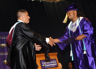 Campbellsville Independent Schools Superintendent Kirby Smith congratulates Ceondre Barnett.