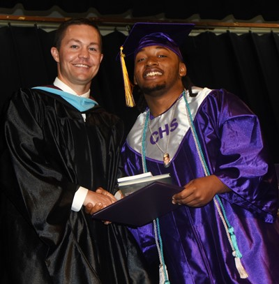 CHS Principal Weston Jones congratulates Ceondre Barnett.