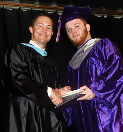 CHS Principal Weston Jones congratulates Cody Cox.