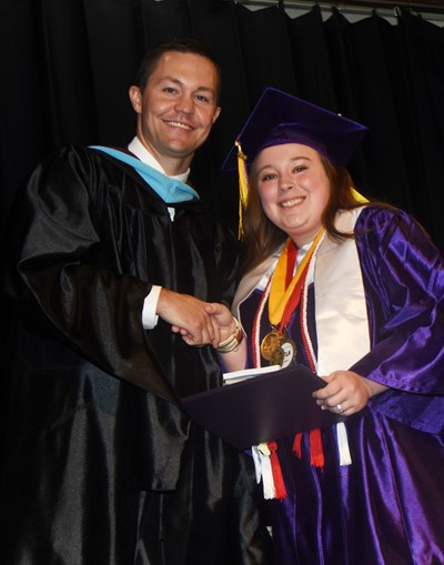 CHS Principal Weston Jones congratulates Destiny Deason.