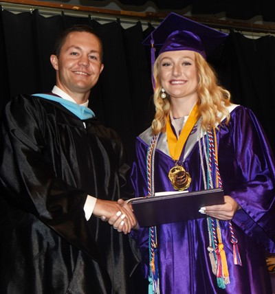 CHS Principal Weston Jones congratulates Abbie Dicken.