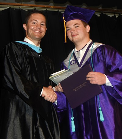 Campbellsville Independent Schools Superintendent Kirby Smith congratulates Josh Dooley.