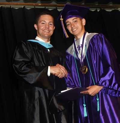 CHS Principal Weston Jones congratulates Casey Hardin.