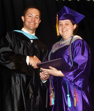 CHS Principal Weston Jones gives Ruby Hatfield her diploma.