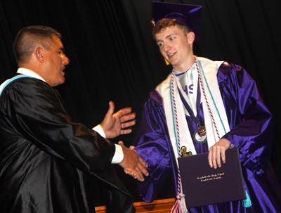 Campbellsville Independent Schools Superintendent Kirby Smith congratulates Jackson Hinton.