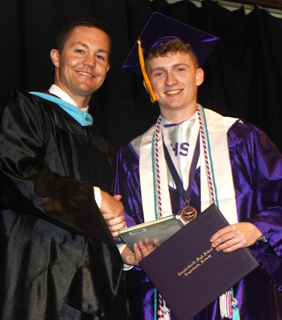 CHS Principal Weston Jones congratulates Jackson Hinton.