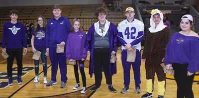 CHS students are recognized as dress-up winners for All Gold Everything Day.