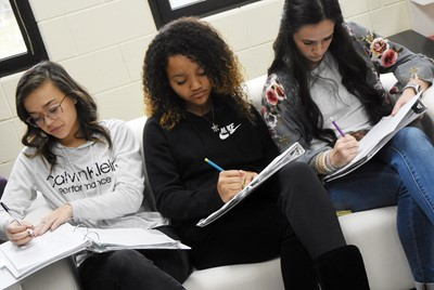 From left, CHS sophomores Tayler Thompson, Alexis Thomas and Sarah Adkins listen as their classmates discuss the poem Half-Hanged Mary.