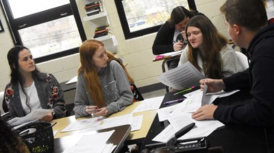 From left, CHS sophomores Sarah Adkins, Hayley Wethington, Skyler Olinski and Blake Settle discuss the poem Half-Hanged Mary with their classmates.