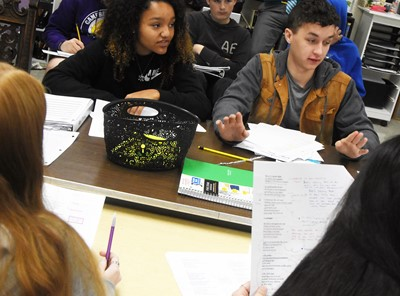 CHS sophomores Alexis Thomas, at left, and Luke VanWinkle discuss the poem Half-Hanged Mary with their classmates.