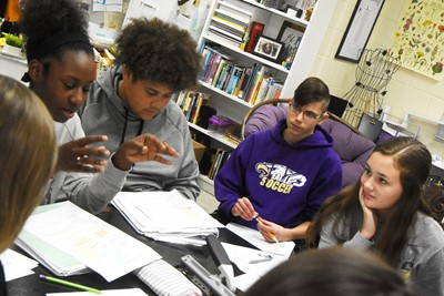 From left, CHS sophomores Myricle Gholston, Brandon Pittman and Grant Lawson and freshman Haylee Allen discuss the poem Half-Hanged Mary with their classmates.