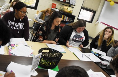 From left, CHS freshman Antaya Epps and sophomores Karley Morris, Sumara Berry and Olivia Fields discuss the poem Half-Hanged Mary with their classmates.