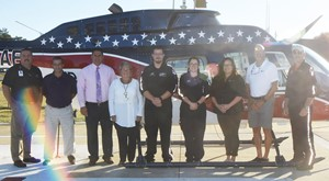 Campbellsville Independent Schools has partnered with Air Evac Lifeteam to provide air medical services for its student athletes. From left are Air Evac Lifeteam Program Director Dan Durham, CIS Youth Sports Director Lynn Kearney, CIS Superintendent Kirby Smith, Taylor Regional Hospital CEO Jane Wheatley, Chad Wheet, Air Evac flight paramedic, Nikki Taylor, Air Evac flight nurse, Air Evac Local Membership Sales Manager Stacey Forbis, CIS Athletic Director Tim Davis and Scott Lorenz, Air Evac base line pilot.