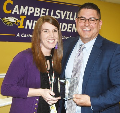 Campbellsville Independent Schools Superintendent Kirby Smith honors Campbellsville Elementary School teacher Jessica Dillon with the certified Change Award.