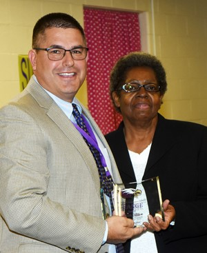 Campbellsville Independent Schools Superintendent Kirby Smith honors CIS cafeteria worker and bus monitor Ruth Allen with the classified Change Award.