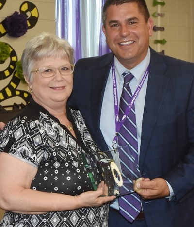 Campbellsville Independent Schools Superintendent Kirby Smith honors Taylor County Adult Learning Center Program Director Midge Hunt with the certified/community Change Award.