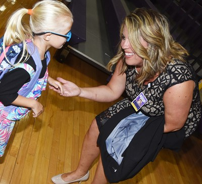 CES Principal Elisha Rhodes greets kindergartener Skyler Bray as they begin the first day of school.
