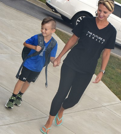 Sheere Newton walks her son, Luke, in for his first day of kindergarten at CES.