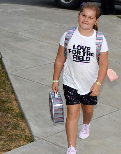 Aubreigh Knifley walks in for her first day of third grade at CES.