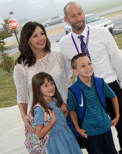 Stephanie and Ben Davis smile for a photo with their children Lylah and Cash as they start their first day of first and second grade, respectively.