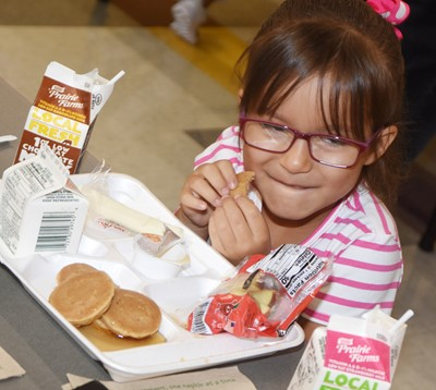 CES kindergartener Kyilee Cox enjoys her breakfast.