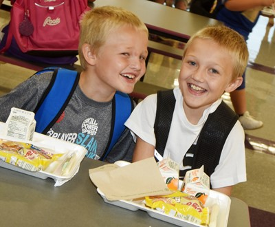 CES third-grader Tristian Harris, at left, and his brother Trenton, a fifth-grader, enjoy breakfast together on the first day of school.