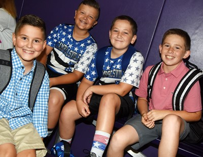 From left, iEagle fifth-graders Tye Rhodes, Cayton Lawhorn, Luke Adkins and Lanigan Price smile as they begin their day.