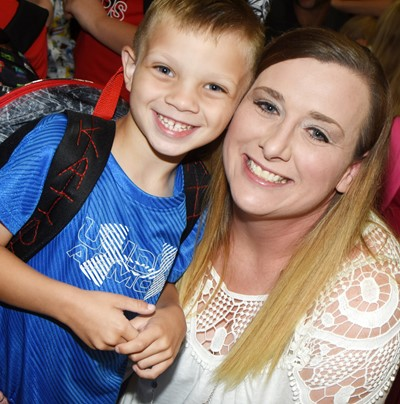 CS kindergartener Kaiden Miller smiles with his mother, Joanie, as he begins his first day of school.