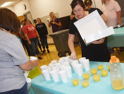 "Susan Kennon, at left, and Courtney Sowell of the CES Family Resource Center host the school's first ""Boo Hoo – Yahoo"" breakfast for kindergarten parents."