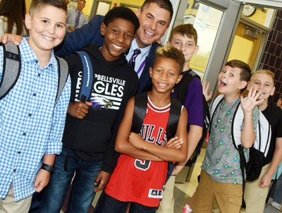 CIS Superintendent Kirby Smith smiles with iEagle students, from left, fifth-graders Tye Rhodes, Jaron Johnson, Rajon Taylor, Aidan Wilson, Ryan Tungate and Joseph Greer as they start their first day.