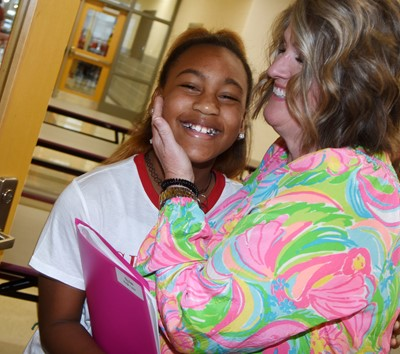 CES Guidance Counselor Donna White greets iEagle fourth-grader Aliy Dunn on the first day of school.