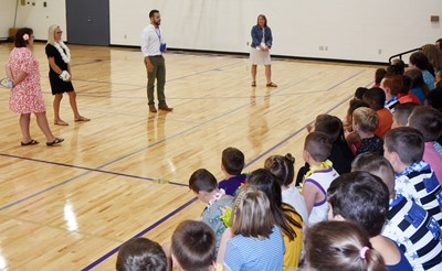 iEagle teachers, from left, Tracey Rinehart, Hannah Jones, Tyler Hardy and Katie Campbell talk to their students on the first day.