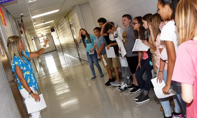 CMS teacher Andrea Gribbins gives her students a tour of the school on the first day of middle school.