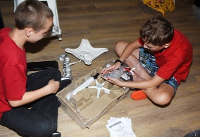 iEagle students Spencer Bates, at left, and Noah Leachman, seventh-graders, work together to put a chair together.