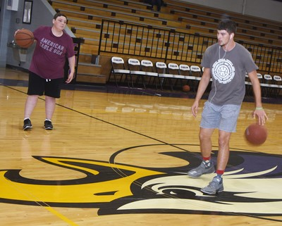 CHS seniors Braydon Phillips, at left, and Mark Rigsby play basketball.