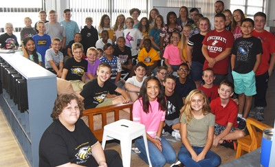 Sixth- and seventh-grade iEagle students smile for a photo on the first day of their program.
