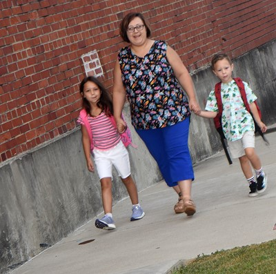 Nicole Britton walks her daughter Tylee, a second-grader at CES, and Cole, a kindergartener, in for the first day of school.