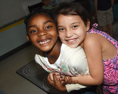 CES second-graders Mariah Harris, at left, and Nevaeh Agent smile together on the first day of school.