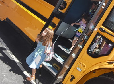 CES first-grader Lylah Davis gets off the bus after her first day of school.