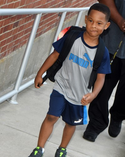 CES first-grader DeVonte Noyola walks in for the first day of school.