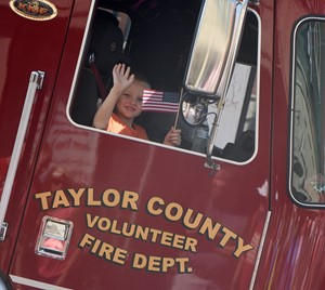 Campbellsville Elementary School fourth-grader Trenton Harris rides in a Taylor County Fire & Rescue truck.