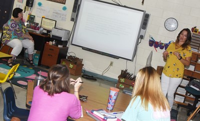 CES teacher Lisa Mardis, at left, and CIS parent Rebecca Sidebottom teach a session on dyslexia.