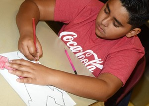 CMS sixth-grader Cody Tamez draws how he feels about being in an art class this school year.