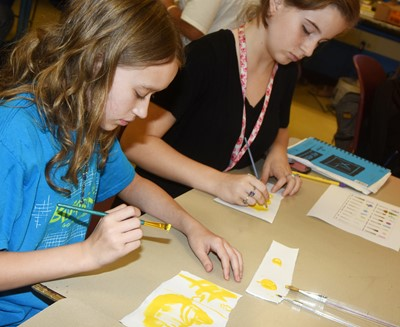 CMS sixth-graders Katie Nunn, at left, and Raegan Hayes try new painting techniques.