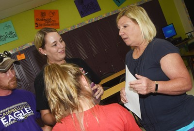 CMS teacher Jan Speer talks to sixth-grader Madisyn Bradfield and her parents Ashley and Kyle.