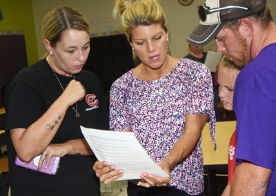 CMS teacher Andrea Gribbins talks to sixth-grader Madisyn Bradfield and her parents Ashley and Kyle.
