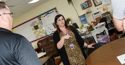CHS teacher Andrea Lawler talks to a student.
