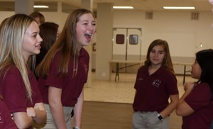 CMS eighth-graders Chloe Thompson, at left, and Ava Hughes share a laugh as they play Would You Rather with their fellow LOCK members.
