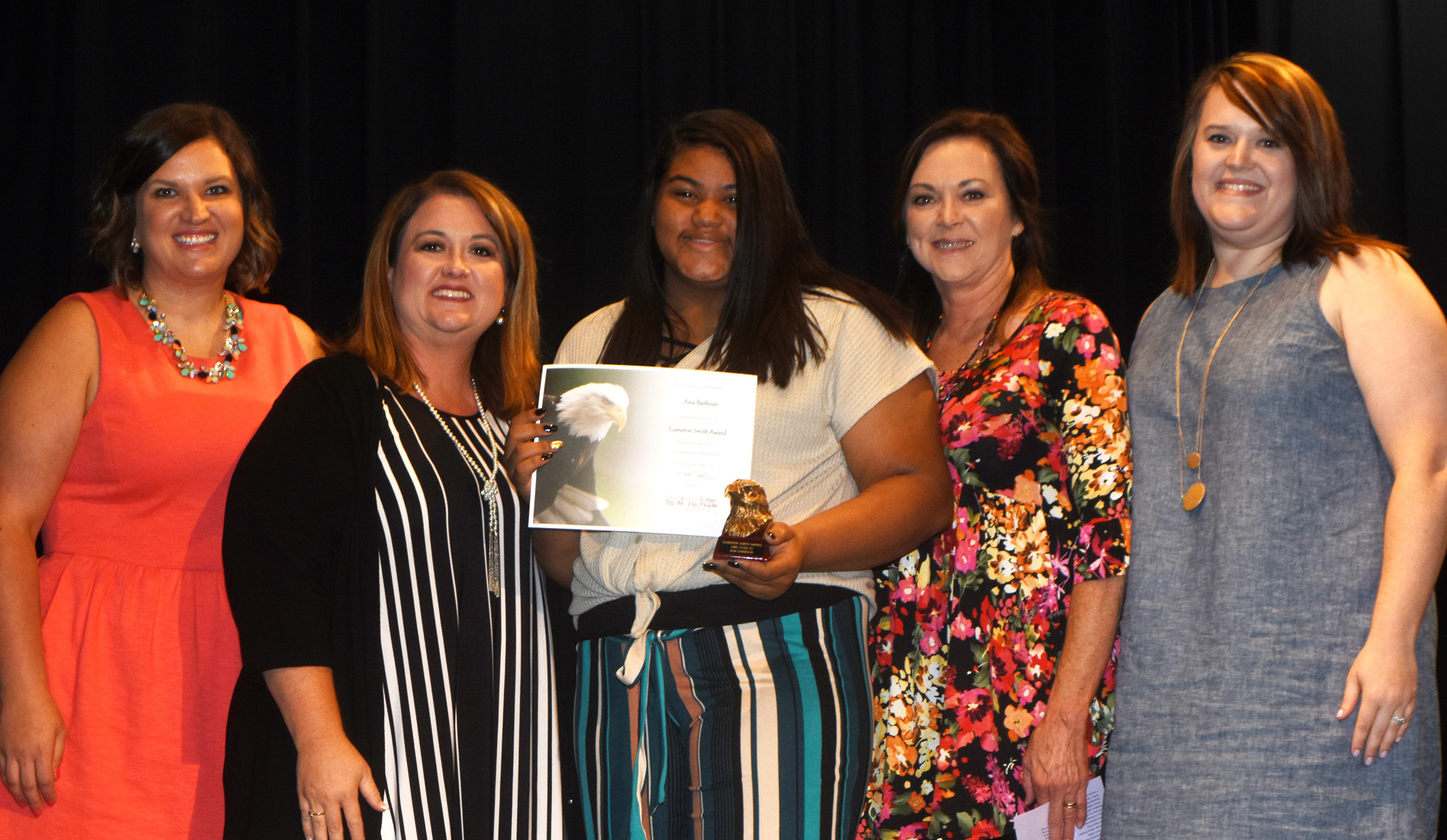 Asia Barbour is honored with the Cameron Smith award. She is pictured with her teachers. From left are Robbilyn Speer, Amy Knifley, Barbour, Melisa Morris and Paige Cook.